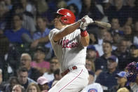 Philadelphia Phillies' J.T. Realmuto watches his single off Chicago Cubs starting pitcher Alec Mills during the sixth inning of a baseball game Wednesday, July 7, 2021, in Chicago. (AP Photo/Charles Rex Arbogast)