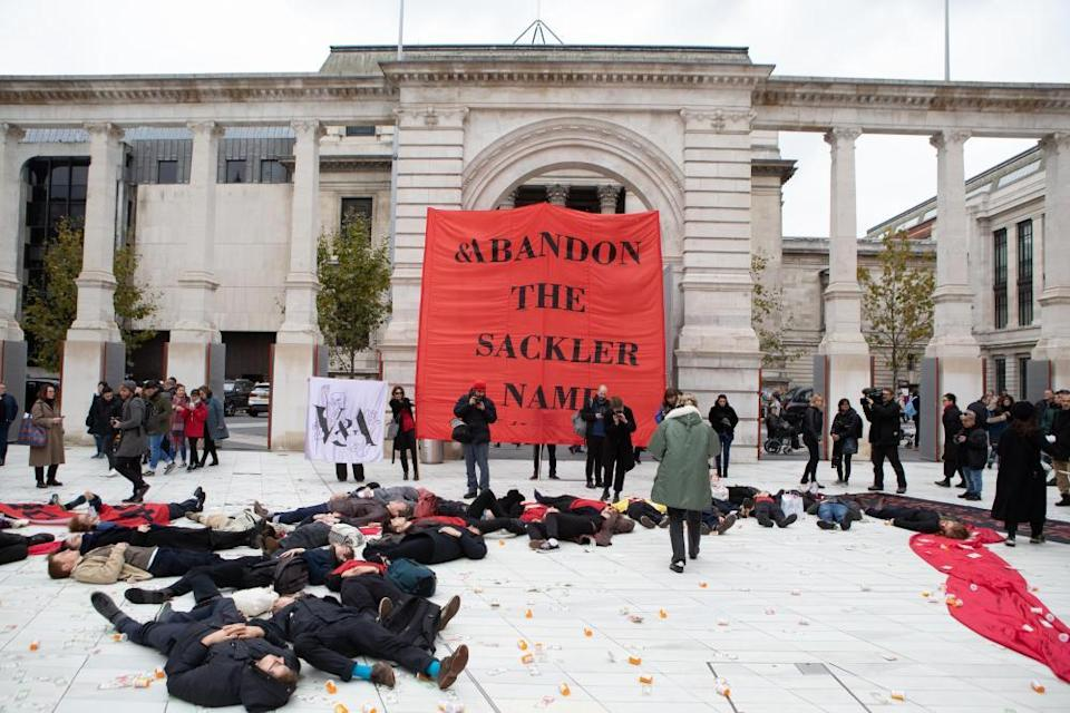 Photographer Nan Goldin with protesters at the V&A's Sackler Centre, calling for the museum to remove the Sackler name from the wing.