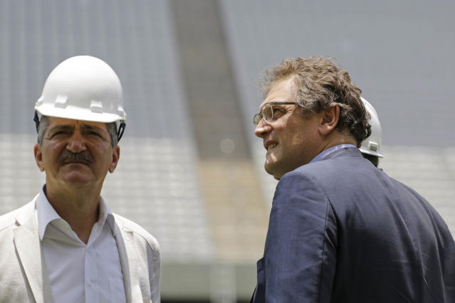 Aldo Rebelo, Brazil Sports Minister, left, and Jerome Valcke, Secretary General of FIFA, right, inspect Arena de Sao Paulo stadium, in Sao Paulo, Brazil, Monday, Jan. 20, 2014. Members of FIFA and the 2014 World Cup Local Organizing Committee started an inspection tour of stadiums in host cities across Brazil. (AP Photo/Nelson Antoine)