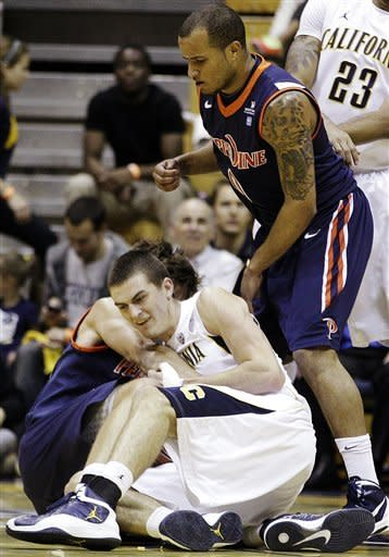 California's David Kravish, bottom, fights for the ball with Pepperdine's Jett Raines as Lorne Jackson (0) watches during the first half of an NCAA college basketball game, Tuesday, Nov. 13, 2012, in Berkeley, Calif. (AP Photo/Ben Margot)