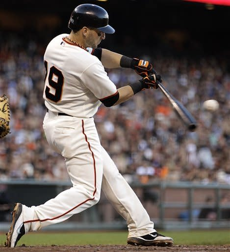 San Francisco Giants' Marco Scutaro connects for an RBI sacrifice fly off Los Angeles Dodgers' Joe Blanton in the inning of a baseball game, Sunday, Sept. 9, 2012, in San Francisco. (AP Photo/Ben Margot)