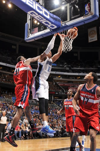 ORLANDO, FL - MARCH 29: Tobias Harris #12 of the Orlando Magic goes up for the monster dunk against the Washington Wizards during the game on March 29, 2013 at Amway Center in Orlando, Florida. (Photo by Fernando Medina/NBAE via Getty Images)