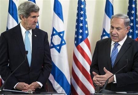 U.S. Secretary of State Kerry listens as Israeli Prime Minister Netanyahu makes a statement to the press before a meeting at the Prime Minister's Office in Jerusalem