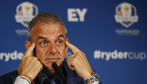 European Ryder cup team captain Paul McGinley touches his face as he listens during a press conference at Wentworth Golf Club to announce his three wild card selections for his team to play at Gleneagles in Scotland against the USA, in Wentworth England, Tuesday, Sept. 2, 2014. (AP Photo/Kirsty Wigglesworth)