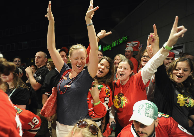 Dani Weadley, center left, of Fox Lake, Ill., cheers with fellow Chicago Blackhawks fans at Harry Caray's Restaurant in Rosemont, Ill., early Tuesday, June 25, 2013, as the Blackhawks players arrived carrying the Stanley Cup after beating the Boston Bruins Monday in the NHL Stanley Cup hockey finals. (AP Photo/Daily Herald, Mark Welsh) MANDATORY CREDIT, MAGS OUT