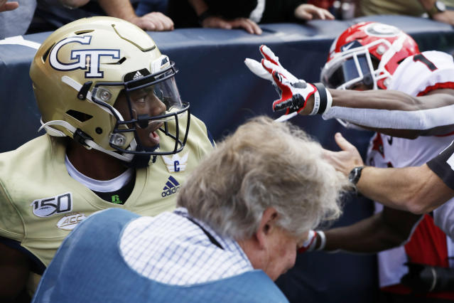 Georgia Tech defensive back Tariq Carpenter (2) reacts as Georgia wide receiver George Pickens (1) goes after him during a fight in the in zone in the second half of an NCAA college football game between, Saturday, Nov. 30, 2019, in Atlanta. Pickens was ejected and Georgia won 52-7. (Joshua L. Jones/Athens Banner-Herald via AP)