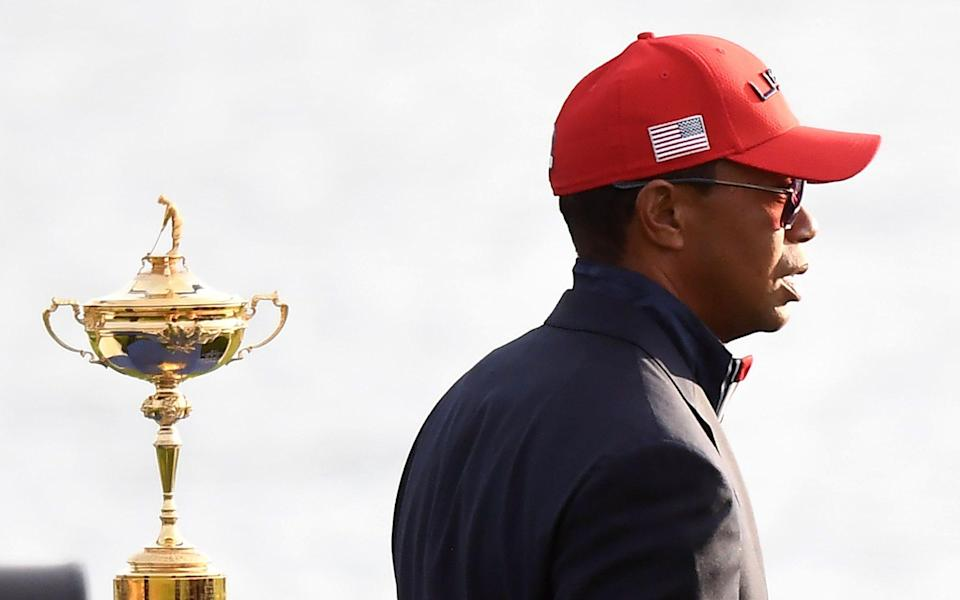 US golfer Tiger Woods walks past the trophy after Europe won the 42nd Ryder Cup at Le Golf National Course at Saint-Quentin-en-Yvelines, south-west of Paris, on September 30, 2018 - FRANCK FIFE/AFP/Getty Images