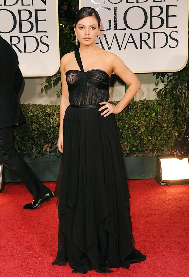 Back in black! Kunis returned to her favorite color to wear on the red carpet for the 2012 Golden Globes, when she wore an asymmetrical Dior gown with a sheer bustier. Cartier jewels and a low bun finished her lovely look. (1/15/2012)