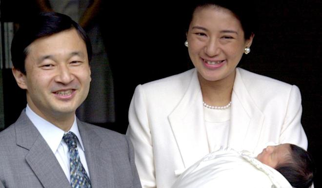 Then-Crown Prince Naruhito and his wife Masako smile as they leave the imperial hospital with their infant daughter Princess Aiko in 2001. Photo: Reuters