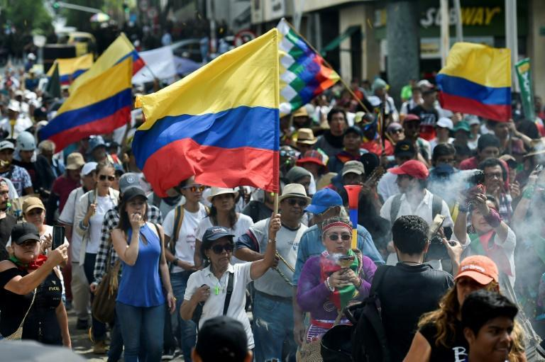 Colombian anti-government protesters march in the city of Cali