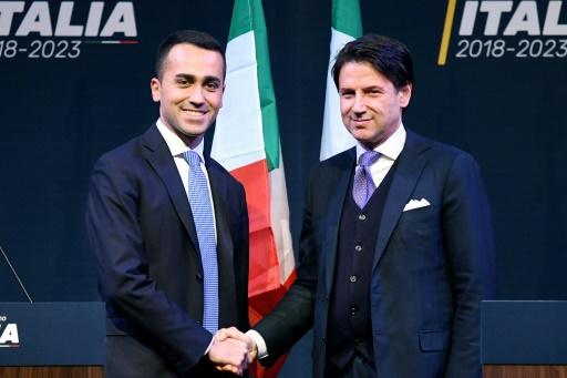 Five Star Movement leader Luigi Di Maio, left, has defended Conte in the scandal over claims on his CV
