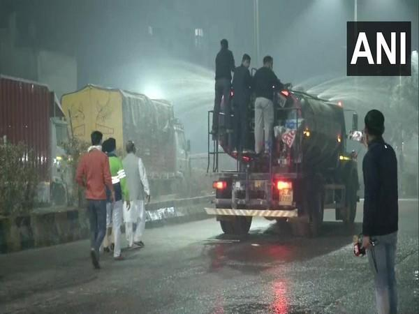 North MCD sprinking water to control air pollution. Photo/ANI