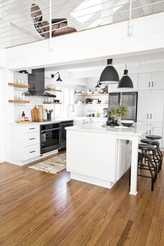 "<p><a href=""http://www.dorseydesigns.com/kitchen-reveal-appliances-with-samsung/"" rel=""nofollow noopener"" target=""_blank"" data-ylk=""slk:Dorsey Designs"" class=""link rapid-noclick-resp"">Dorsey Designs</a> opted for a backsplash of white subway tiles and tore down the wall of cabinets separating the kitchen from the living space to make it feel more open and spacious. The kitchen island also introduces extra seating and useable space. </p>"