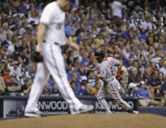 Washington Nationals' Anthony Rendon, right, rounds the bases after his home run off Milwaukee Brewer relief pitcher Will Smith during the eighth inning of a baseball game Tuesday, June 24, 2014, in Milwaukee. (AP Photo/Jeffrey Phelps)