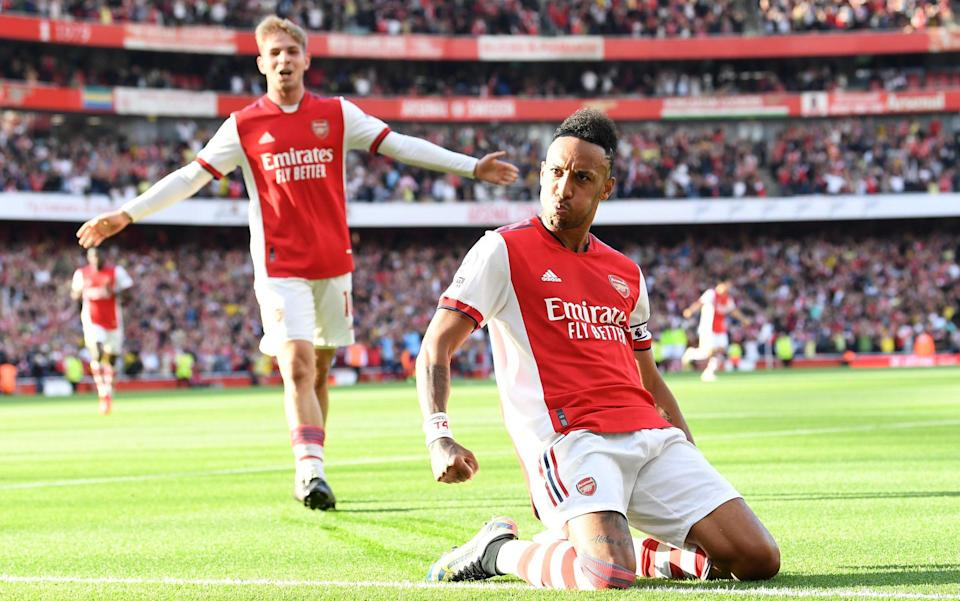 Pierre-Emerick Aubameyang celebrates scoring Arsenal's 2nd goal during the Premier League match between Arsenal and Tottenham Hotspur at Emirates Stadium on September 26, 2021 in London, England. - GETTY IMAGES