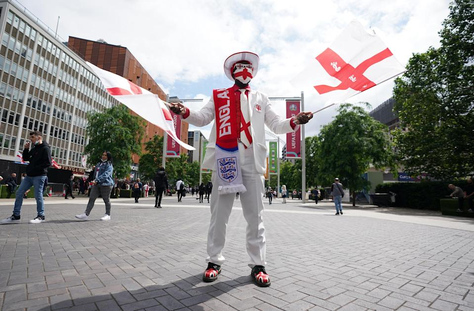 An England fan outside Wembley Stadium ahead of the Euro 2020 semi-final between England and Denmark (PA Wire)