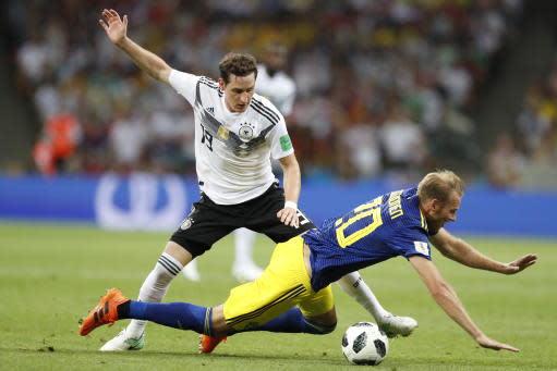 Sweden's Ola Toivonen falls in front of Germany's Sebastian Rudy during the group F match between Germany and Sweden at the 2018 soccer World Cup in the Fisht Stadium in Sochi, Russia, Saturday, June 23, 2018. (AP Photo/Rebecca Blackwell)