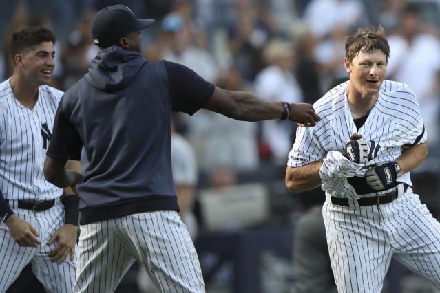 New York Yankees' DJ LeMahieu, right, celebrates with his teammates after hitting the game-winning walk off home run in the 11th inning of a baseball game against the Oakland Athletics, Saturday, Aug. 31, 2019, in New York. (AP Photo/Mary Altaffer)