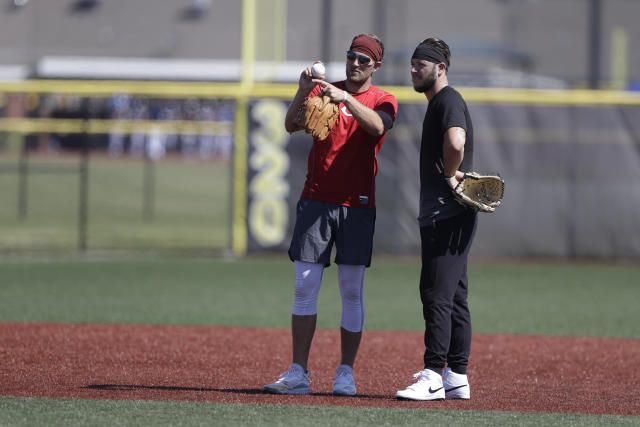 Cincinnati Reds pitcher Justin Shafer, left, talks with Nolan Watson during a workout at Grand Park, Friday, June 12, 2020, in Westfield, Ind. Proceeds from the event will go to Reviving Baseball in the Inner City of Indianapolis. (AP Photo/Darron Cummings)