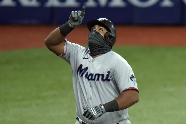 Miami Marlins' Jesus Aguilar celebrates his solo home run off Tampa Bay Rays' Josh Fleming during the fourth inning of a baseball game Friday, Sept. 4, 2020, in St. Petersburg, Fla. (AP Photo/Chris O'Meara)