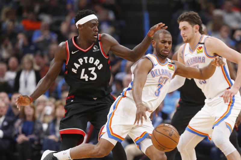 Oklahoma City Thunder guard Chris Paul (3) drives past Toronto Raptors forward Pascal Siakam (43) during the first half of an NBA basketball game Wednesday, Jan. 15, 2020, in Oklahoma City. (AP Photo/Sue Ogrocki)
