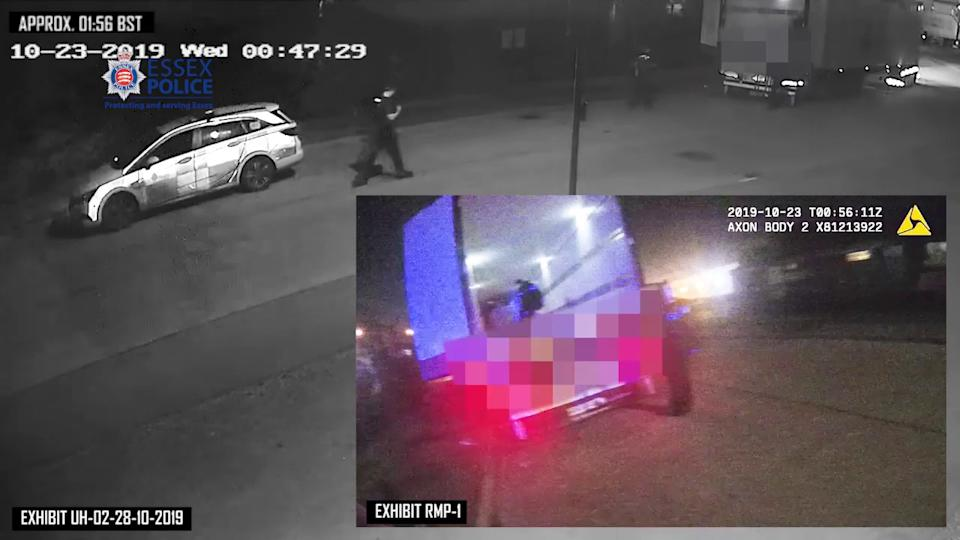 Screengrab taken from bodyworn video on 23 October issued by Essex Police showing officers after being called to the container when the bodies were found. (PA/Essex Police)