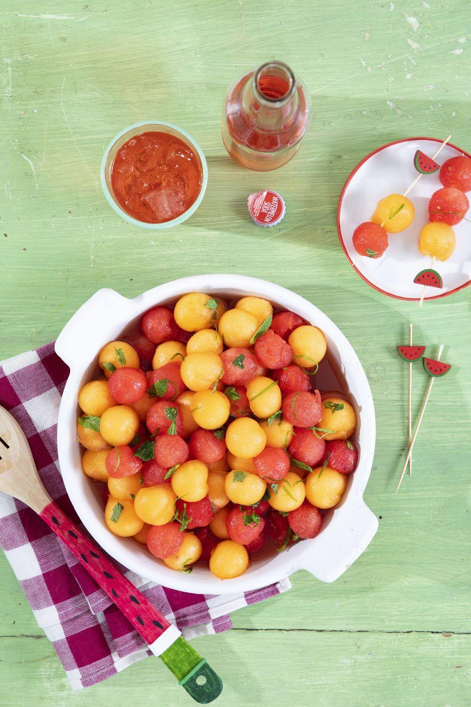 """<p>Serve this sweet fruit salad, and you'll be taking home an empty bowl.</p><p><strong><a href=""""https://www.countryliving.com/food-drinks/a36301828/marinated-melon-with-mint-and-lime-zest-recipe/"""" rel=""""nofollow noopener"""" target=""""_blank"""" data-ylk=""""slk:Get the recipe"""" class=""""link rapid-noclick-resp"""">Get the recipe</a>.</strong></p>"""