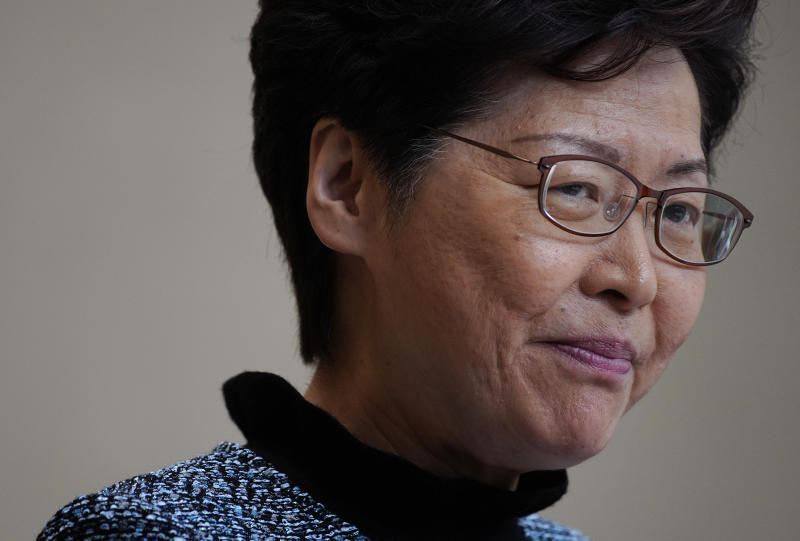 Hong Kong Chief Executive Carrie Lam attends a press conference in Hong Kong, Tuesday, Oct. 29, 2019. Hong Kong's leader says the city is at risk of falling into a recession as it enters its fifth month of pro-democracy protests, and she says her priority was ending violence first before a political resolution. (AP Photo/Vincent Yu)
