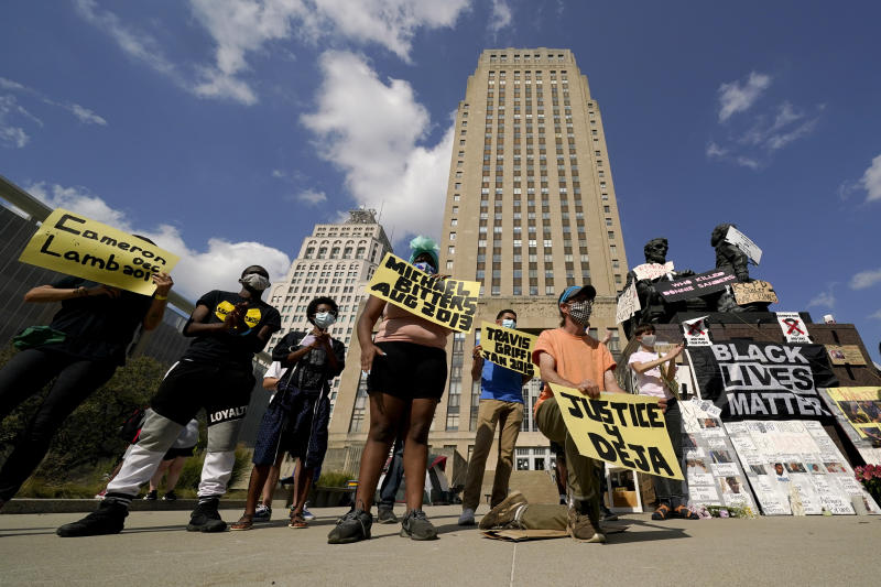 Protesters have occupied the lawn and plaza in front of city hall for more than a week demanding the resignation of police chief Rick Smith and more. (AP Photo/Charlie Riedel)