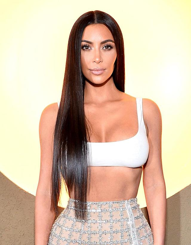 <p>She celebrated Balmain's first Los Angeles boutique wearing long bone straight brunette hair – very similar to iconic singer Cher's statement 'do. (Photo: Getty) </p>