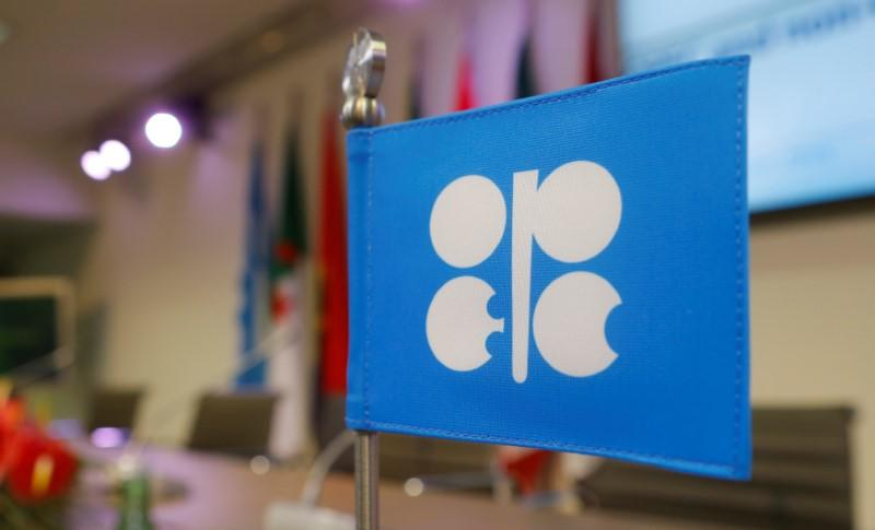A flag with the OPEC logo is seen before a news conference in Vienna