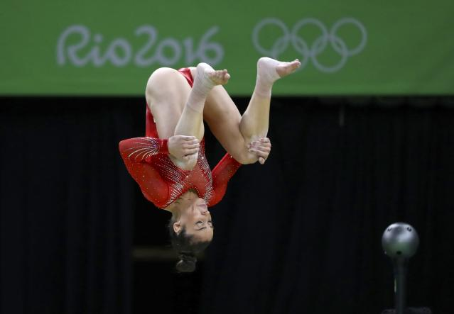 2016 Rio Olympics - Artistic Gymnastics - Final - Women's Individual All-Around Final - Rio Olympic Arena - Rio de Janeiro, Brazil - 11/08/2016. Alexandra Raisman (USA) of the U.S. dismounts from the balance beam. REUTERS/Mike Blake FOR EDITORIAL USE ONLY. NOT FOR SALE FOR MARKETING OR ADVERTISING CAMPAIGNS.