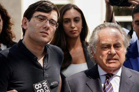 FILE PHOTO: Former drug company executive Martin Shkreli stands with his attorney Benjamin Brafman after exiting U.S. District Court upon being convicted of securities fraud, in the Brooklyn borough of New York City, U.S. on August 4, 2017. REUTERS/Carlo Allegri/File Photo