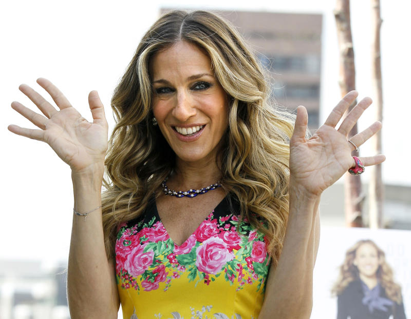 FILE - In this Sept. 1, 2011 file photo, actress Sarah Jessica Parker poses for photographers in London. Sarah Jessica Parker, Kerry Washington and Forest Whitaker are signing up for a new initiative Monday with the Obama administration to adopt some of the nation's worst-performing schools and help turn them around by integrating arts education throughout the schools.  (AP Photo/Kirsty Wigglesworth, File)