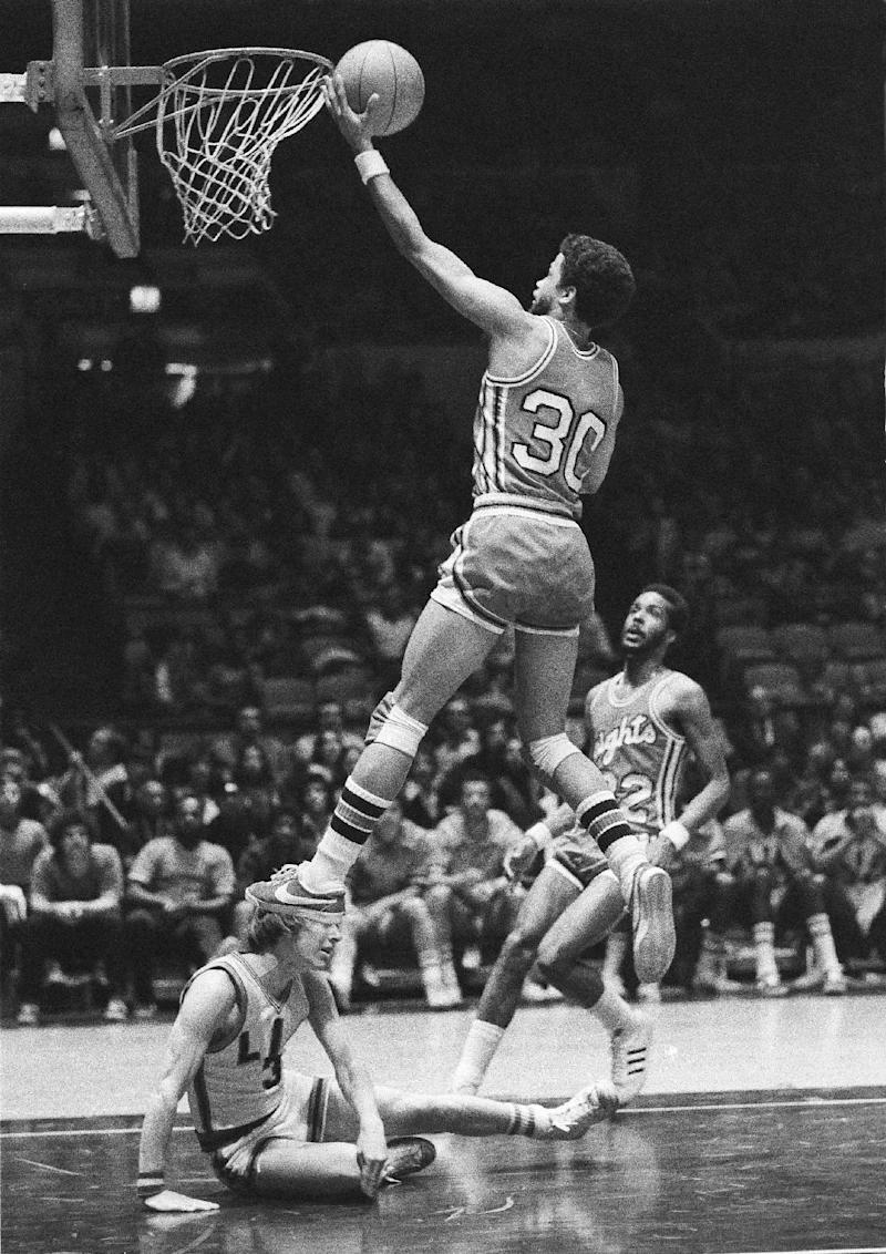 FILE - In this Feb. 28, 1976 file photo, Rutgers' Eddie Jordan (30) goes up to score over fallen Bill Rose, of Long Island University, during the first half of an NCAA college basketball game at New York's Madison Square Garden. Jordan, now an assiatant with the Los Angeles Lakers, has reached a tentative agreement to become coach at Rutgers, the AP is told.  (AP Photo/Suzanne Vlamis, File)