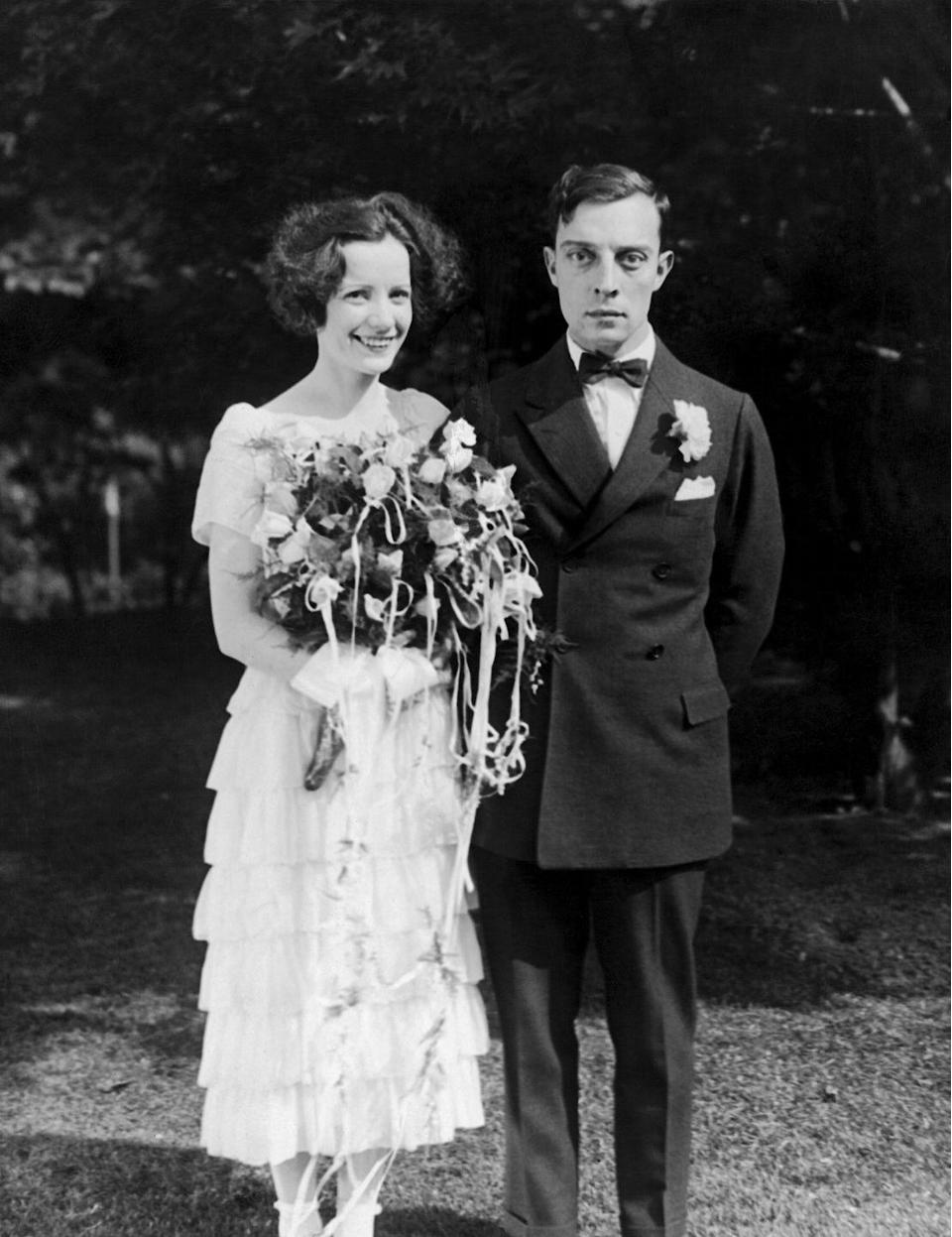"<p>Silent film actress Natalie Talmadge married Hollywood great Buster Keaton in 1921, carrying a bouquet of roses intertwined with long ribbon streamers, <a href=""http://www.fashion-era.com/Weddings/1922-old-wedding-photos.htm"" rel=""nofollow noopener"" target=""_blank"" data-ylk=""slk:a popular bouquet style in the U.S."" class=""link rapid-noclick-resp"">a popular bouquet style in the U.S.</a> at the time.</p>"