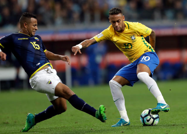 FILE - In this Aug. 31, 2017 file photo, Brazil's Neymar, right, controls the ball against Ecuador's Pedro Quinones, left, during a 2018 World Cup qualifying soccer match in Porto Alegre, Brazil. (AP Photo/Andre Penner, File)