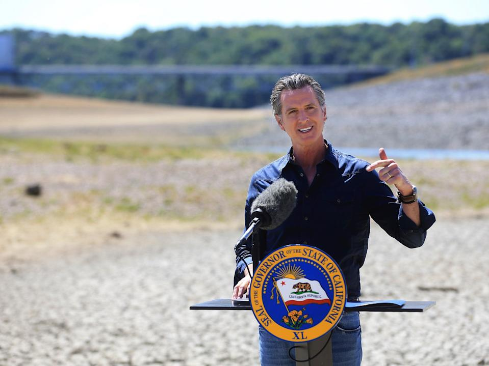 <p>California Gov Gavin Newsom speaks at a news conference in the parched basin of Lake Mendocino in Ukiah, California on Wednesday, 21 April 2021</p> (AP)