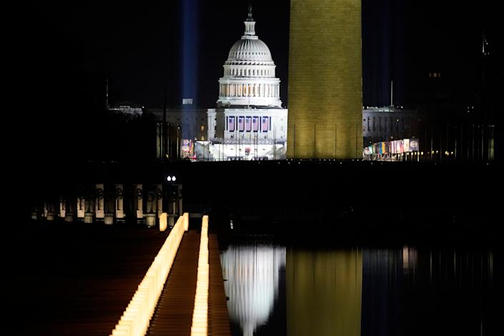 <p>The US Capitol Building is reflected in the Lincoln Memorial Reflecting Pool during a televised ceremony on January 20, 2021 in Washington, DC</p> (Getty Images)