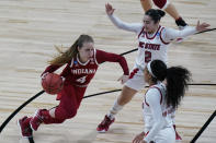 Indiana guard Nicole Cardano-Hillary (4) drives against North Carolina State guard Raina Perez (2) during the second half of a college basketball game in the Sweet Sixteen round of the women's NCAA tournament at the Alamodome in San Antonio, Saturday, March 27, 2021. (AP Photo/Eric Gay)