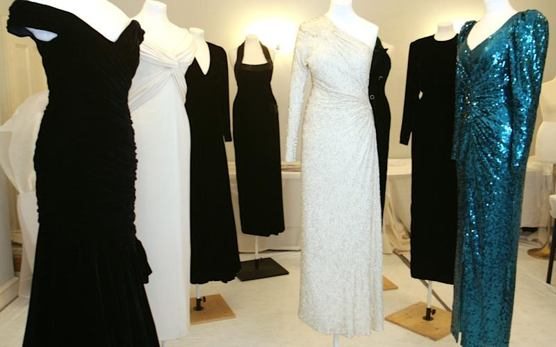 Dresses which belonged to the late Princess Diana are prepared for an exhibition at Kensington Palace - Credit: IJO