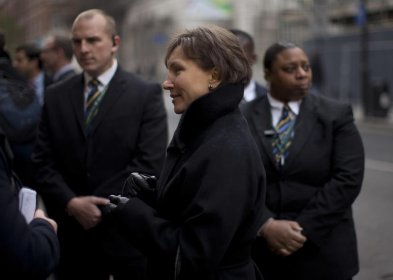 "Marina Litvinenko, center, the widow of former Russian intelligence officer Alexander Litvinenko, is flanked by security workers whilst speaking to a journalist as she leaves at the end of a Pre-Inquest Review at Camden Town Hall in London, Thursday, Dec. 13, 2012. A lawyer has told a British inquest into the poisoning death of former Russian agent Alexander Litvinenko that an initial assessment of evidence showed that the Russian state was responsible for his murder. Hugh Davies, the inquest's counsel, told a London hearing that a ""high-level assessment"" of material provided by the British government ""does establish a case for the Russian state's culpability"" in the murder of Litvinenko, who died in November 2006 after drinking tea laced with the rare radioactive isotope polonium-210 at a London hotel. (AP Photo/Matt Dunham)"