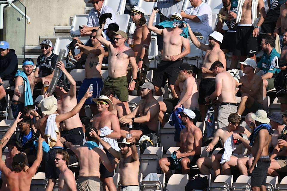 New Zealand supportes cheer on the final day of the ICC World Test Championship Final between New Zealand and India at the Ageas Bowl in Southampton, southwest England on June 23, 2021. - RESTRICTED TO EDITORIAL USE (Photo by Glyn KIRK / AFP) / RESTRICTED TO EDITORIAL USE (Photo by GLYN KIRK/AFP via Getty Images)