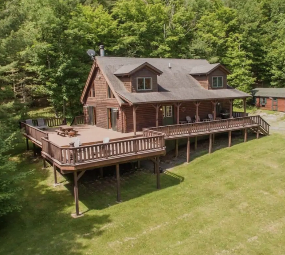 """<h2>Delaware County, New York</h2><br><strong>Location:</strong> Margaretville, NY<br><strong>Sleeps:</strong> 8<br><strong>Price Per Night:</strong> <a href=""""https://airbnb.pvxt.net/b3kAAx"""" rel=""""nofollow noopener"""" target=""""_blank"""" data-ylk=""""slk:$750"""" class=""""link rapid-noclick-resp"""">$750</a><br><br>""""Welcome to the Country Cabin! Sitting on seven acres, just 10 minutes from downtown Margaretville, we are perfectly situated less than 15 minutes from everything you may need — skiing, hiking, wedding venues, etc. Our cozy cabin is the ideal place to hide away, recharge the battery, and find peace & quiet on a private road. Enjoy the oversized deck, vast yard, basketball court, fire pits, spacious living area, river rock fireplace, fully stocked kitchen, expansive game room, and comfortable bedrooms.""""<br><br><h3>Book <a href=""""https://airbnb.pvxt.net/b3kAAx"""" rel=""""nofollow noopener"""" target=""""_blank"""" data-ylk=""""slk:Secluded Oasis"""" class=""""link rapid-noclick-resp"""">Secluded Oasis</a></h3>"""