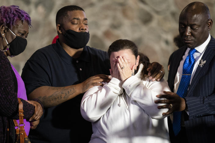 Katie Wright, mother of the deceased Daunte Wright, center, is comforted by her husband Aubrey, second from left, and attorney Ben Crump, right, after speaking during a news conference at New Salem Missionary Baptist Church, Thursday, April 15, 2021, in Minneapolis. (AP Photo/John Minchillo)