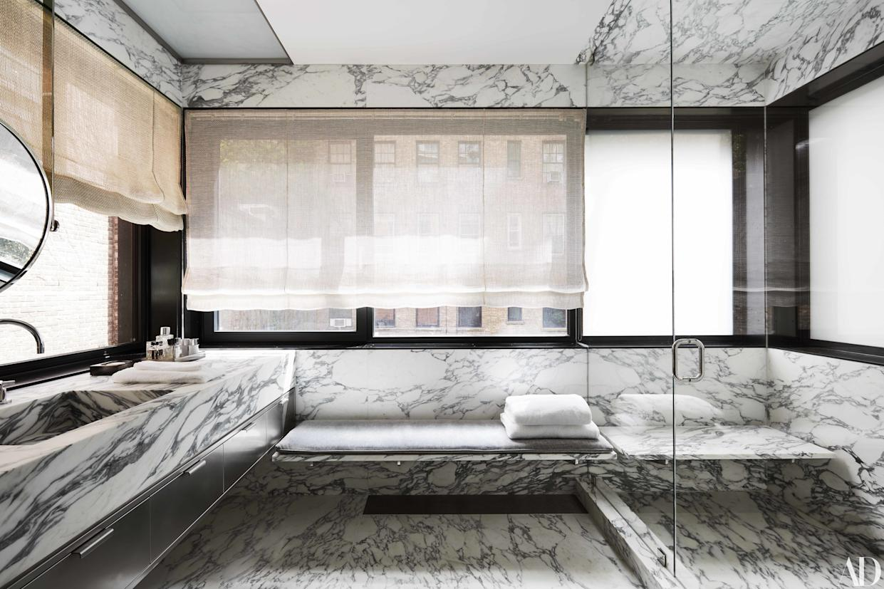 """<div class=""""caption""""> Arabescato Cervaiole marble covers Warren's master bath, where the sink fittings are by Dornbracht </div>"""