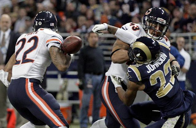 St. Louis Rams cornerback Trumaine Johnson, right, forces Chicago Bears running back Matt Forte, left, to fumble as Bears fullback Tony Fiammetta (43) watches during the first quarter of an NFL football game on Sunday, Nov. 24, 2013, in St. Louis. The Rams' James Laurinaitis recovered the fumble. (AP Photo/Tom Gannam)