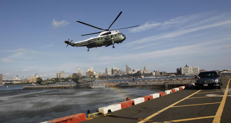 Marine One helicopter, with President Barack Obama aboard, is seen landing at the Wall Street Heliport in New York, Monday, July, 30, 2012. Obama is traveling to New York for a private fundraiser. (AP Photo/Pablo Martinez Monsivais)