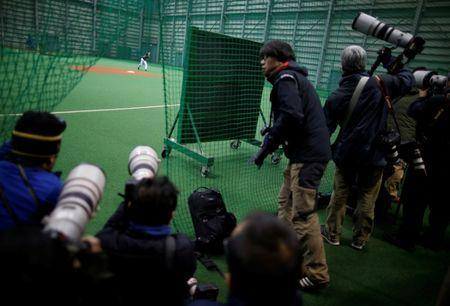 Media members crowd to report on Japanese pitching and hitting star Shohei Ohtani during his workout ahead of his move to the Los Angeles Angels in Kamagaya, east of Tokyo, Japan January 5, 2018. REUTERS/Issei Kato