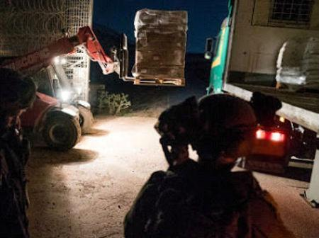 An undated image from material released on June 29, 2018 by the Israeli military relates to an Israeli humanitarian aid supply over the border to Syria.  IDF/Handout via Reuters